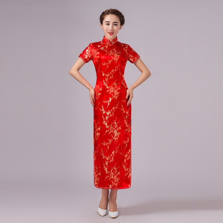 Lastest Women Present Cheongsam, A Traditional Chinese Womens Dress, Also Known As Qipao, At A Pear Garden In Huangping Village Of Xuanen County, Central