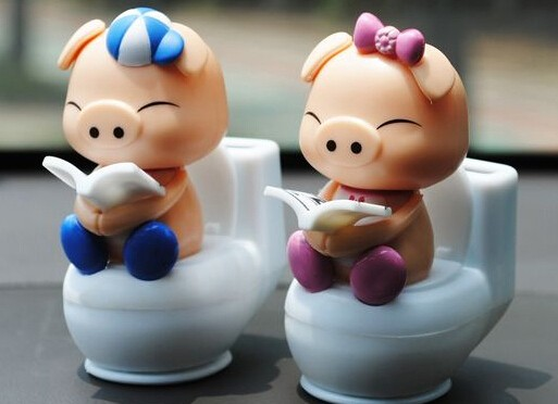 2015 New Cute Cartoon Lovely Dolls Reading Pig ABS + Resin With A Bobble Head Car Styling Mini Solar Powered Shaking Head Toys(China (Mainland))