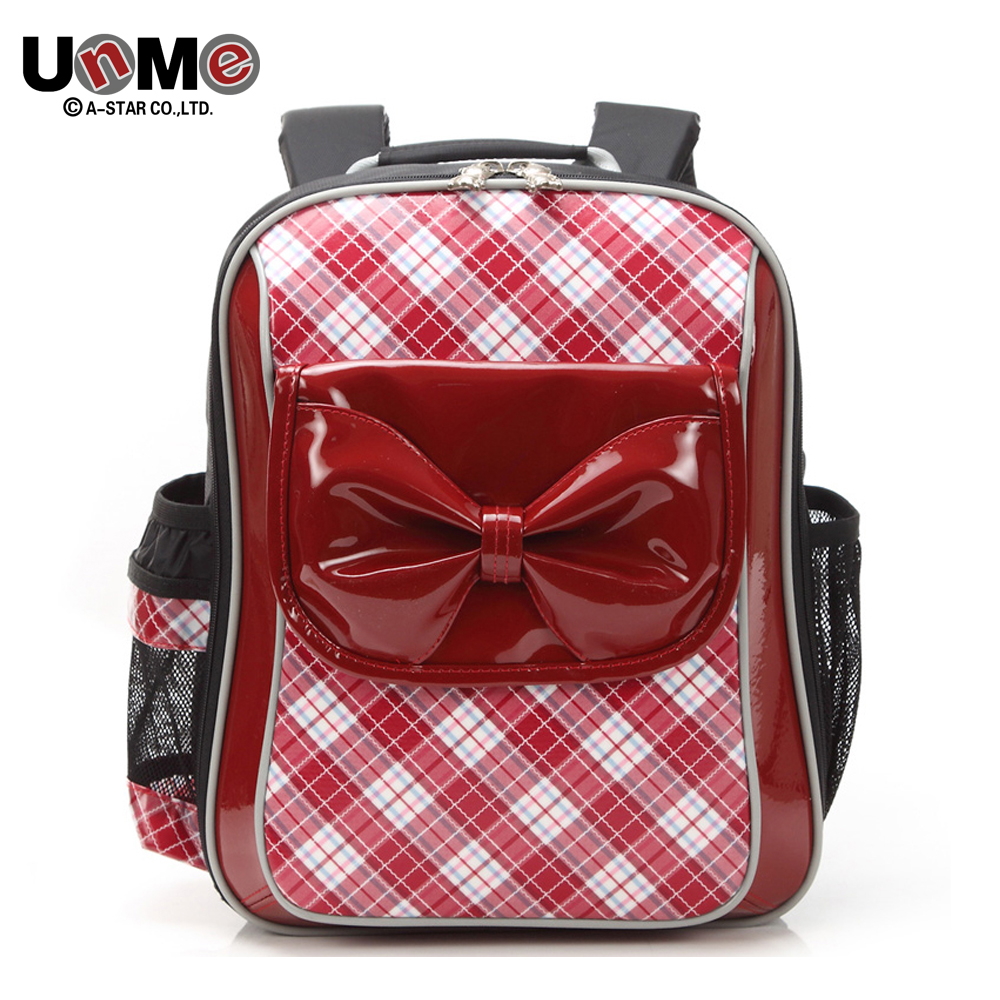UNME high-end brand student spinal support bag Backpack for girls Children schoolbag for 1-3 grade(China (Mainland))