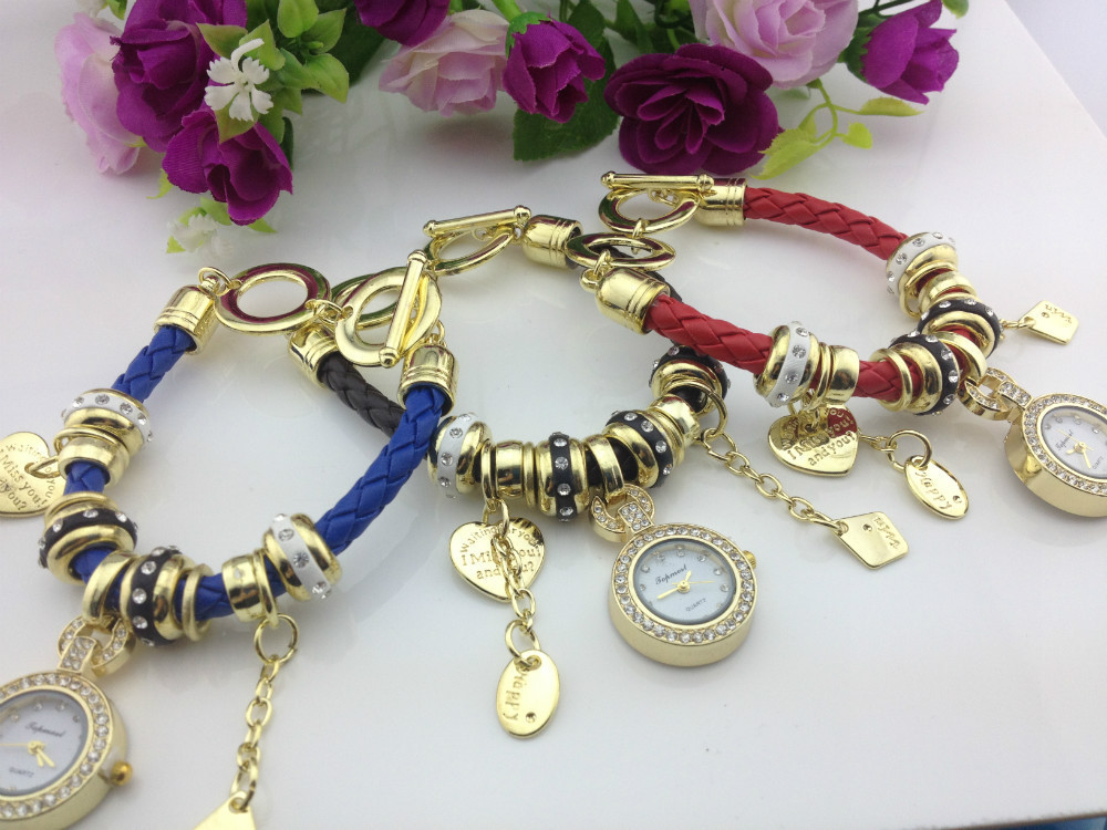 The new female table style and personality of the new ribbon diamond-encrusted bracelet watch gold pendant watch(China (Mainland))